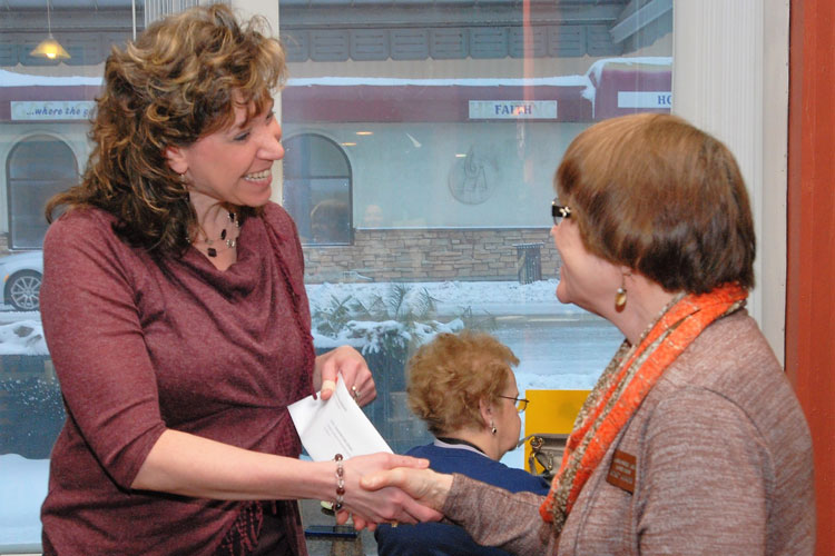 Jodie Veleke of the Clintonville School District receives a grant from CAF Treasurer Kathy Mitchell.